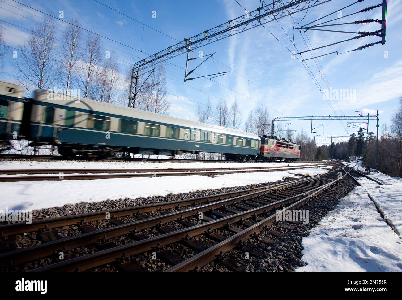 Finnish National Railroad company's (VR) passenger train using electric locomotive , Finland - Stock Image