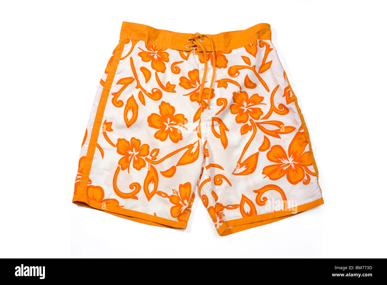 Orange floral pattern swimming trunks isolated on white. - Stock Image