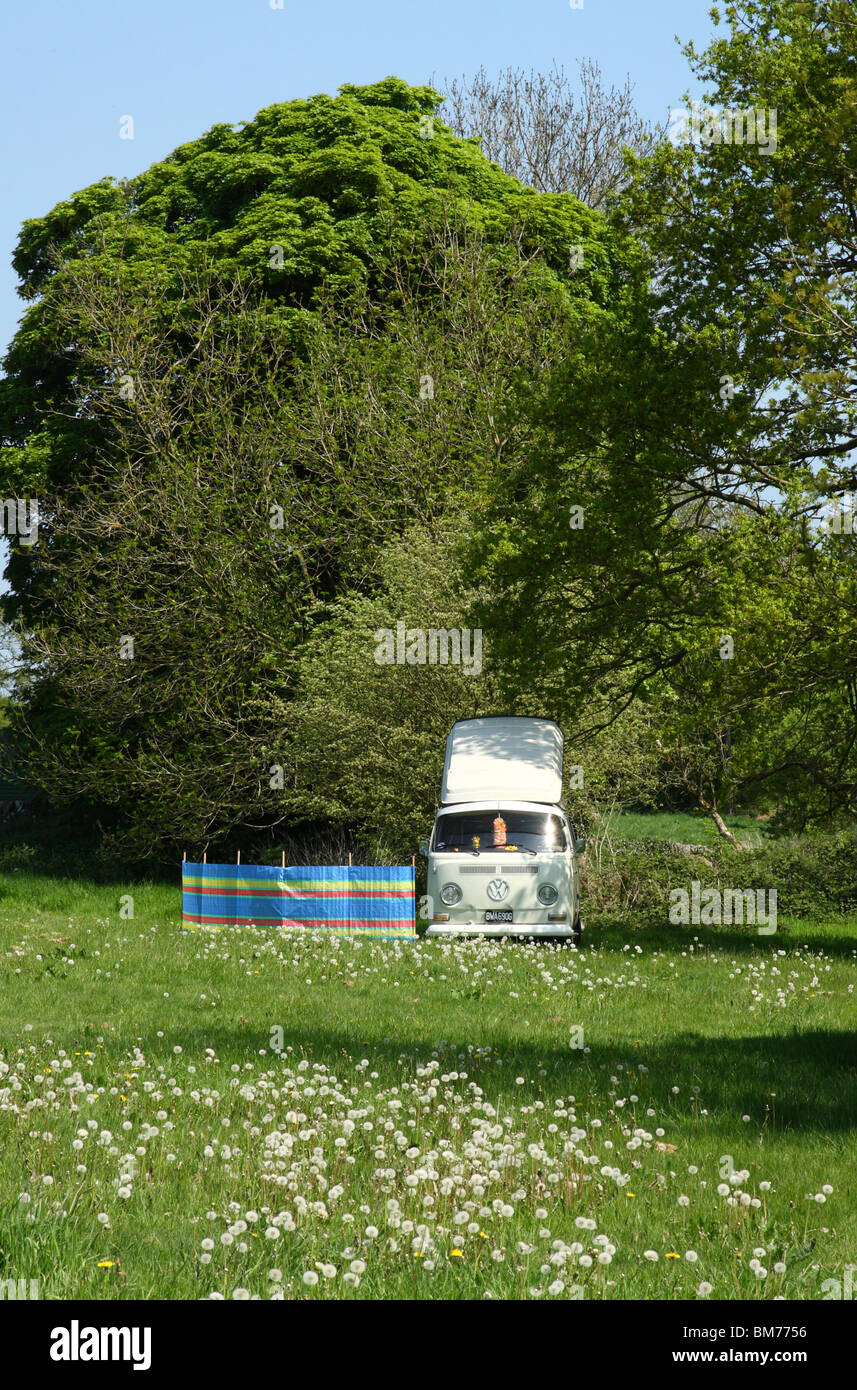 A VW campervan in the English countryside. - Stock Image