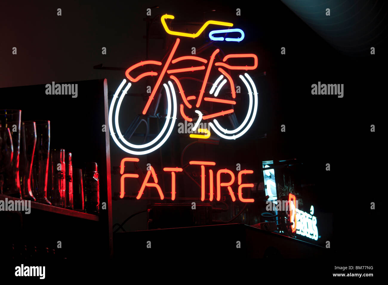 Fat Tire neon sign in a Denver bar. Fat Tire is an amber ale by the New Belgium Brewing Company from Fort Collins, - Stock Image