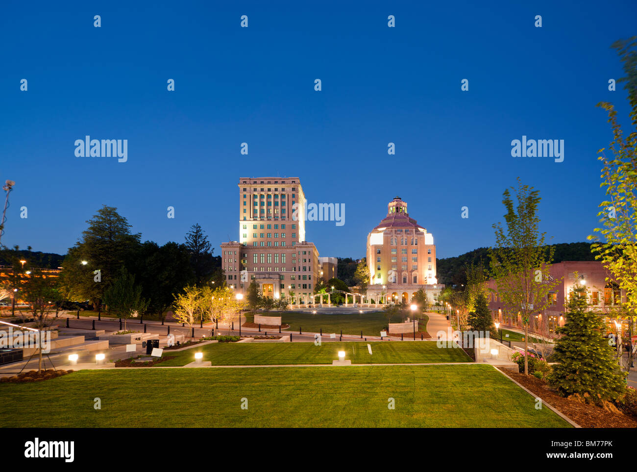 Downtown Asheville, North Carolina, NC. View of Art Deco architecture of City Hall and Court House building at dusk - Stock Image