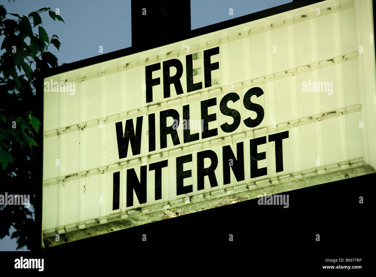 A sign saying Wirless Internet instead of Wireless. In front of a motel, hotel in Asheville NC. - Stock Image