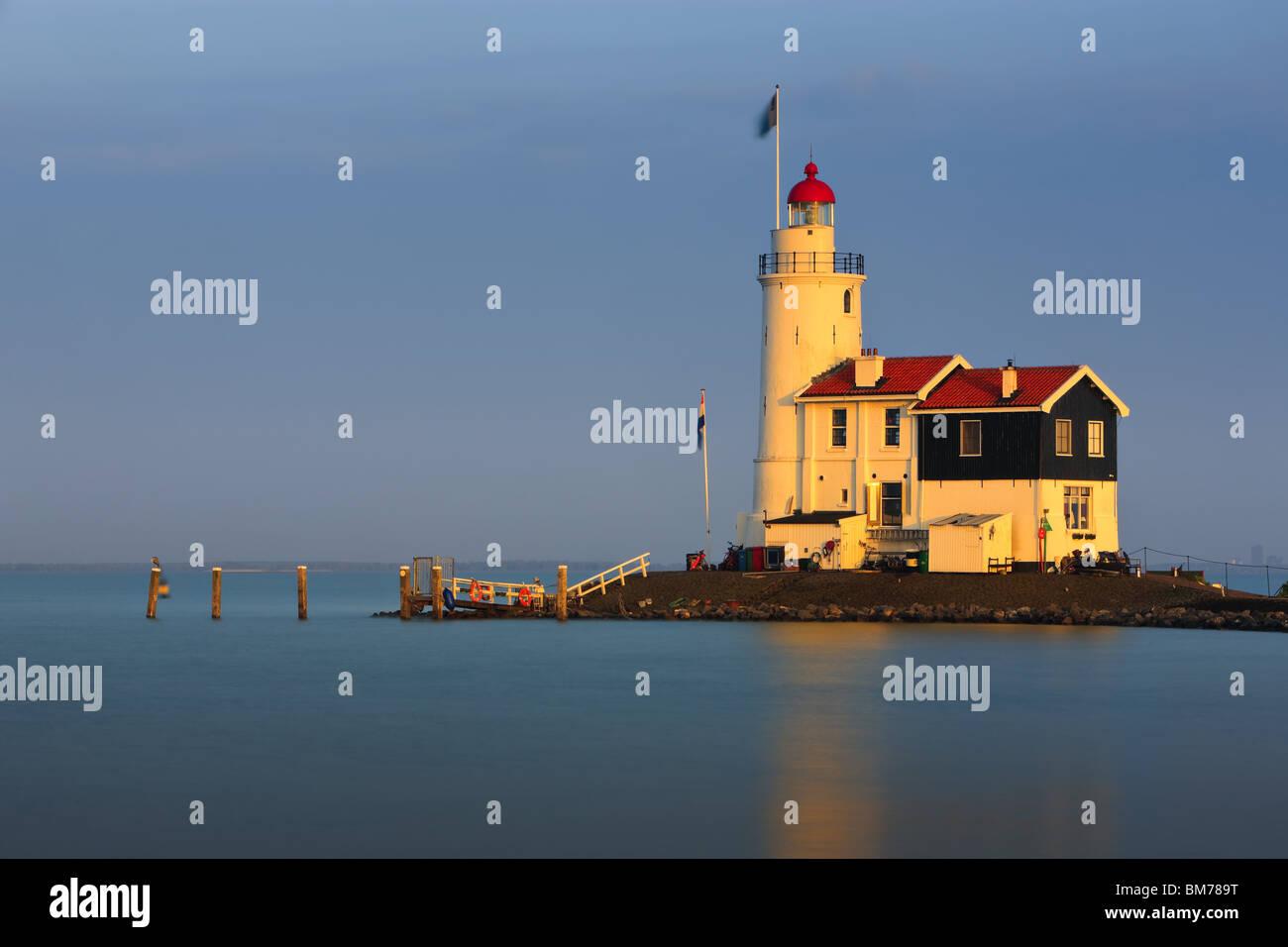 Lighthouse Paard van Marken at sunset - Stock Image