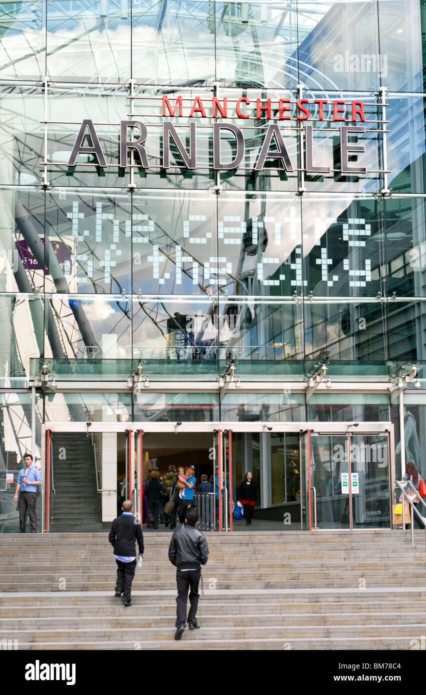 Shoppers outside the Arndale shopping centre in Manchester, England, UK - Stock Image