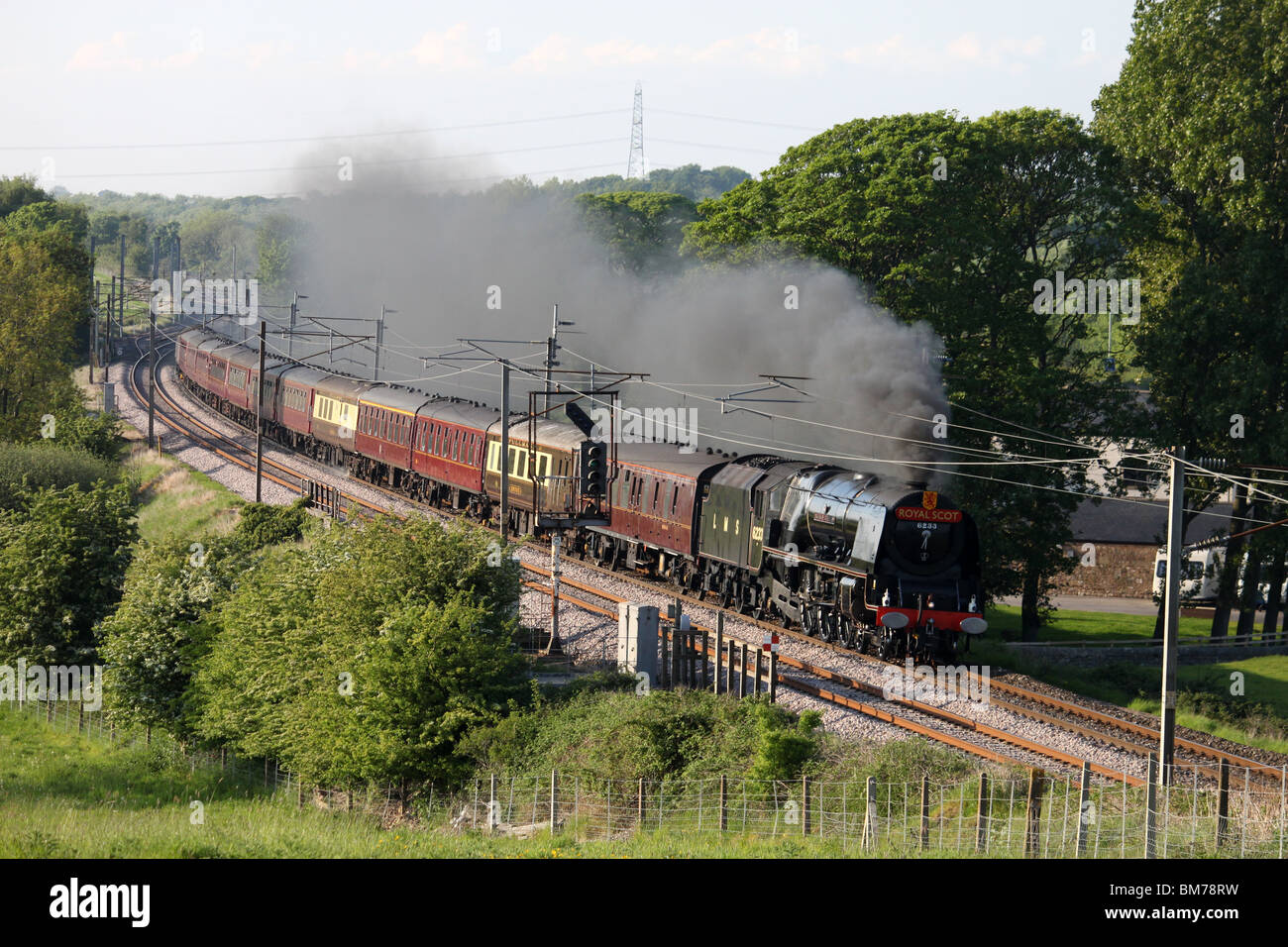 Steam train Duchess of Sutherland on the West Coast Main Line south of Lancaster - Stock Image