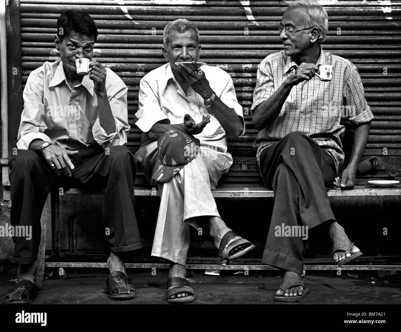 men drink tea in the old town in Ahmedabad, Gujurat India - Stock Image