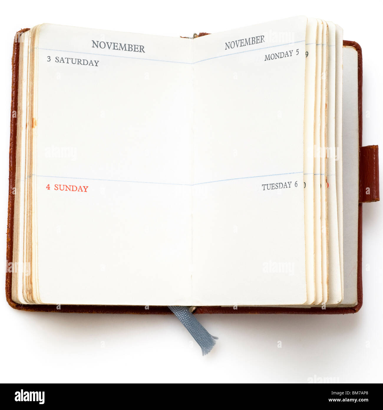 an old leather-cover calendar on white - Stock Image