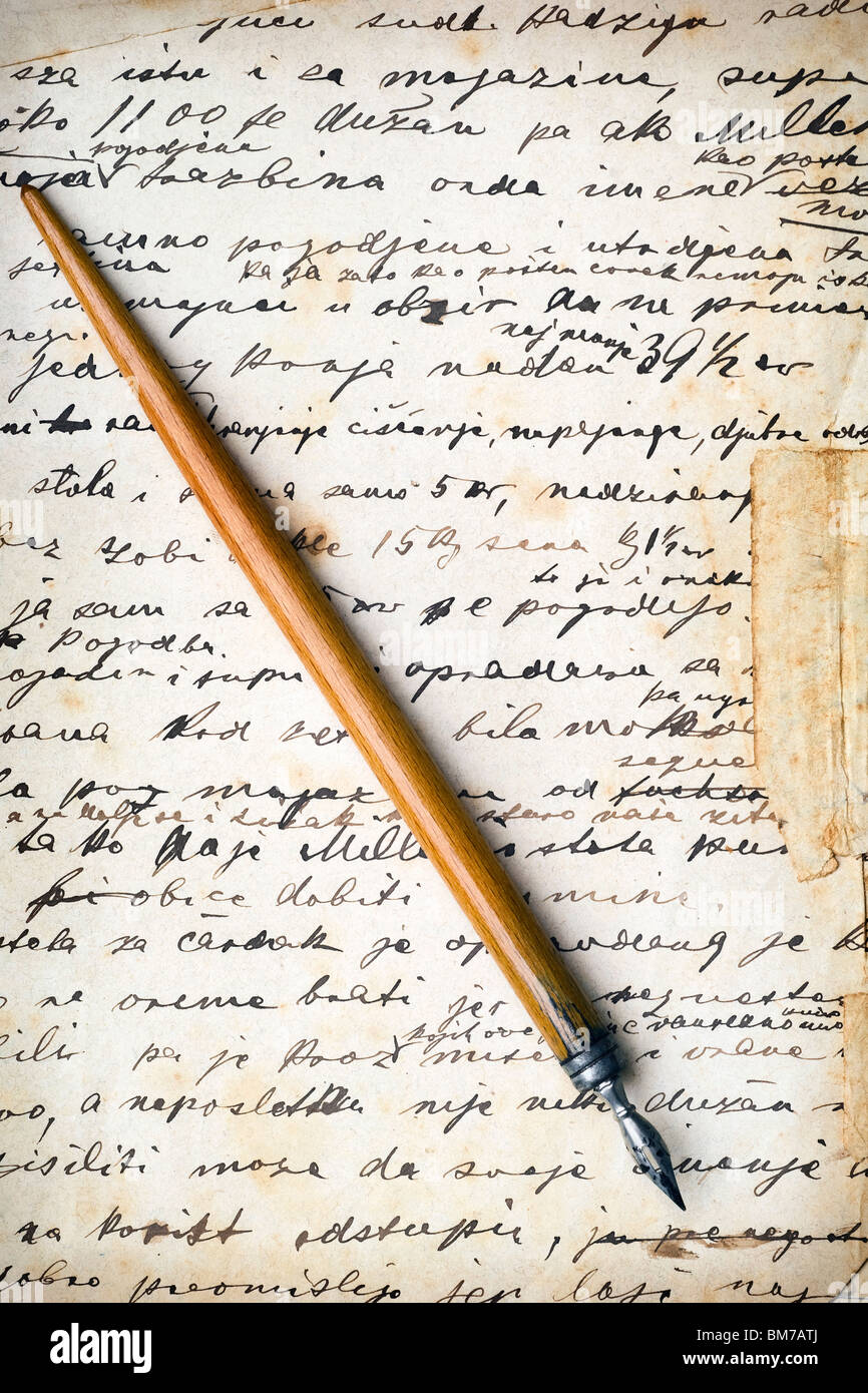 vintage pen on an old letter - Stock Image