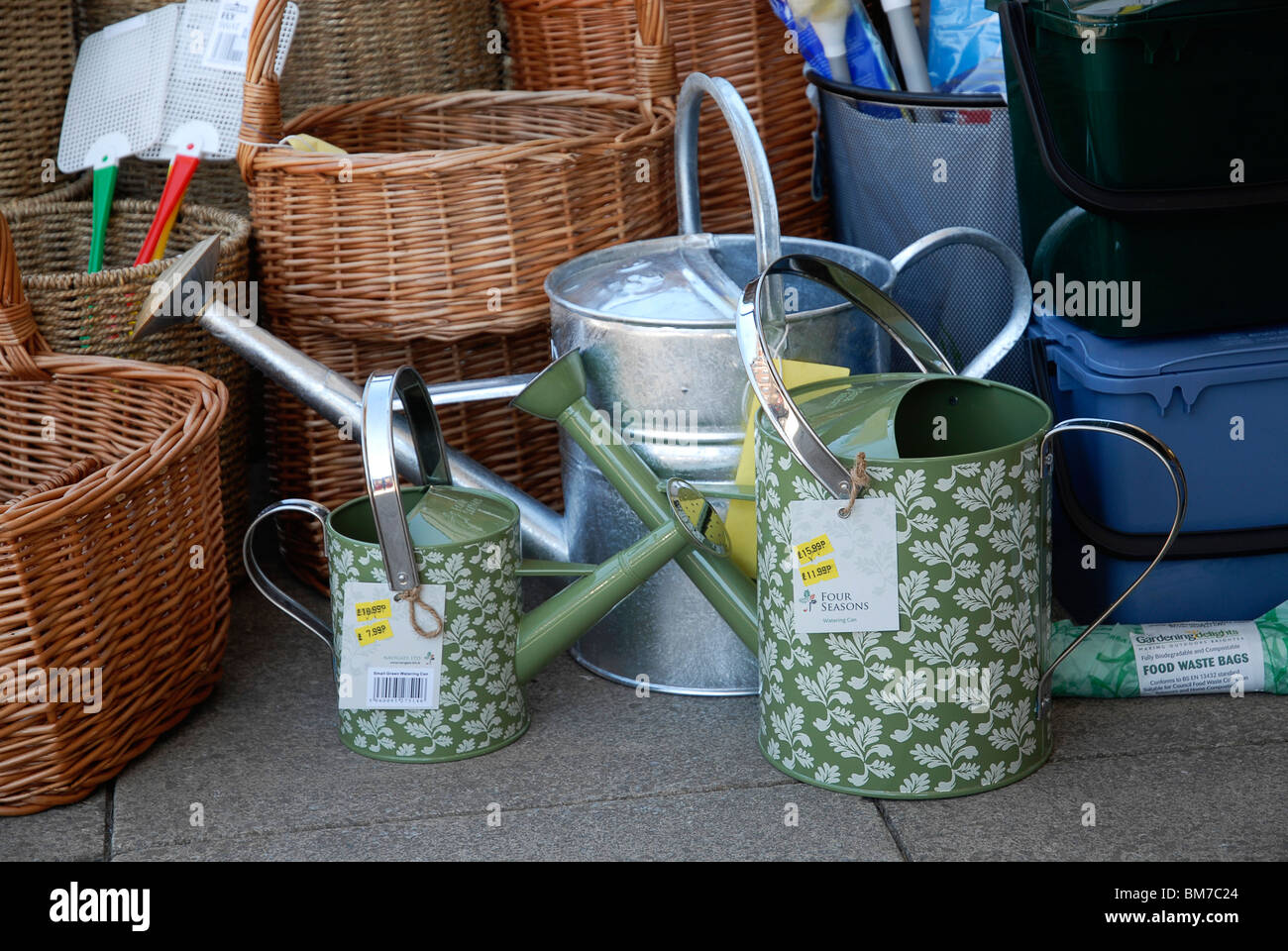 Watering cans outside Frank Gilberts Hardware Store in Market Harborough, Leics., UK. - Stock Image