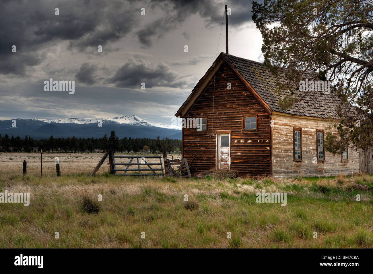 HDR Landscape Old School House With Dramatic Sky Stock Photo