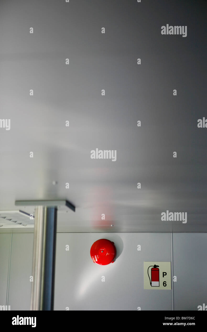 A fire alarm on the wall of a nautical vessel - Stock Image