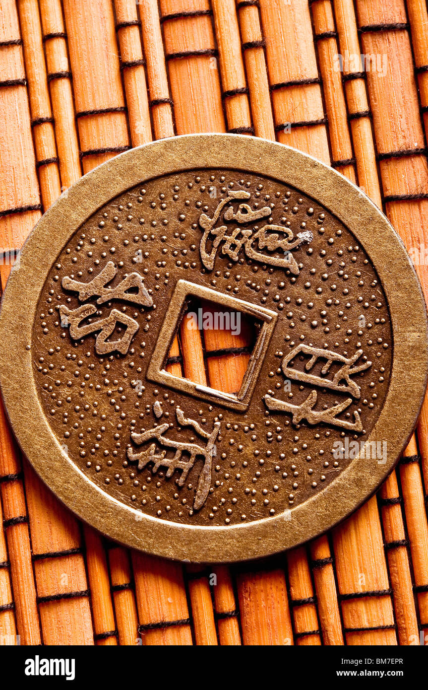 chinese coin for i-ching divination - Stock Image