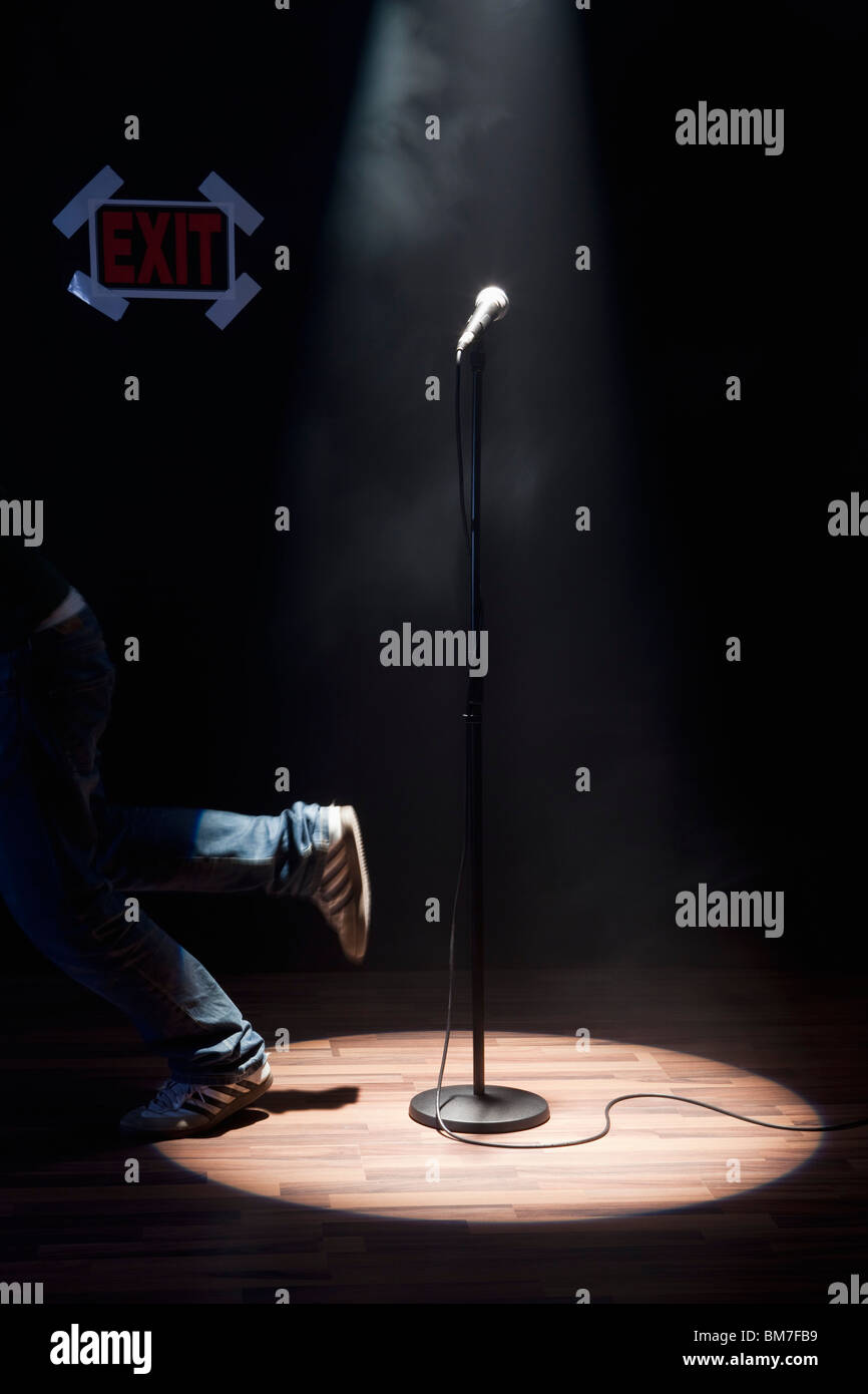 A Person Running Off A Stage - Stock Image