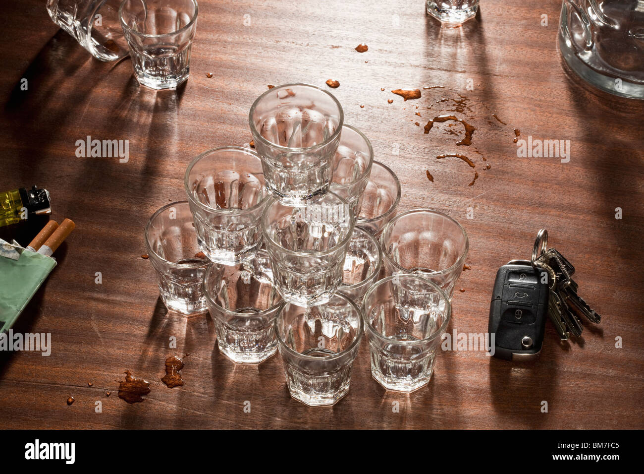Glasses Stacked On Top Of Each Other On A Messy Table - Stock Image