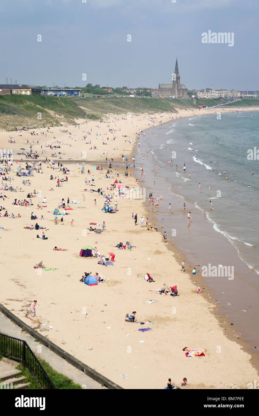 People enjoying a mini heat wave on the 23rd May 2010 on the Long Sands at Tynemouth, England, UK - Stock Image