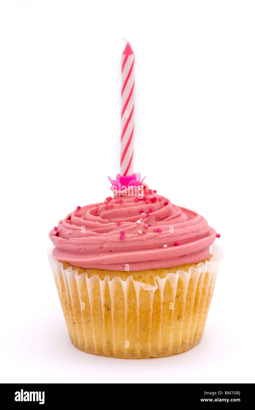 pink cupcake with candle on a white background - Stock Image