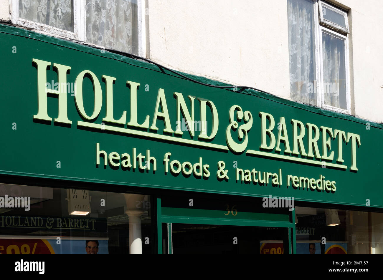 a holland and barrett health food store in devon, uk - Stock Image