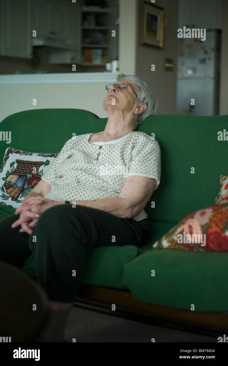 Old Woman Sits On Couch Stock Photos Old Woman Sits On Couch