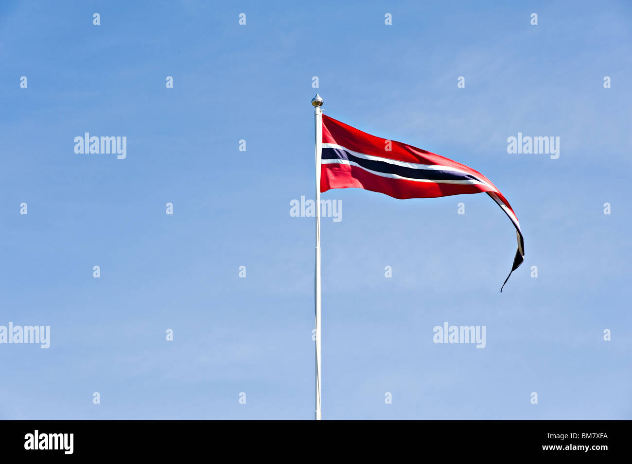 A Norwegian Vimple [Pennant], Narrow Long Flag Flying from Flagpole in Clear Blue Sky in Bergen Norway - Stock Image
