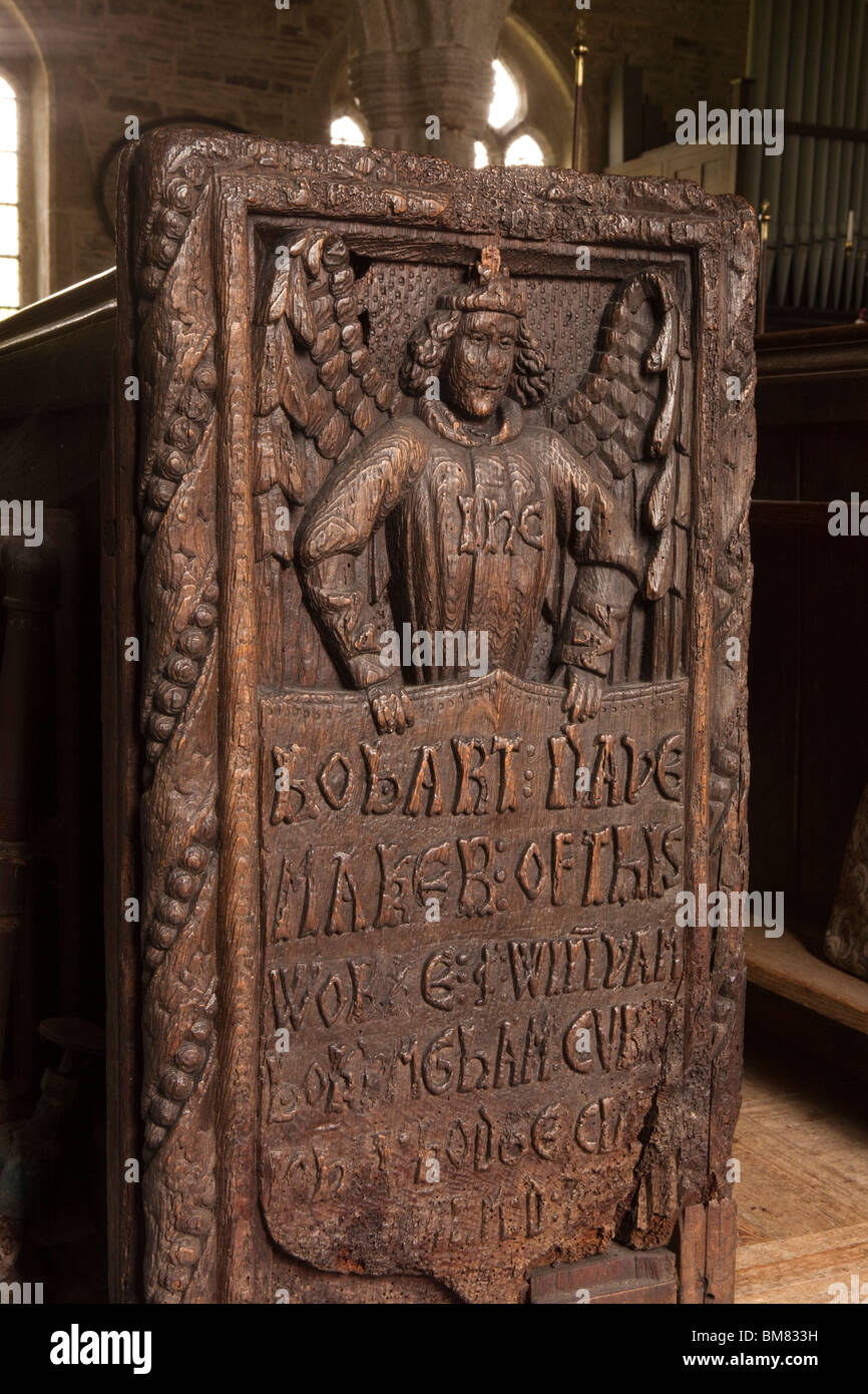 UK, Cornwall, Altarnun, St Nonna's Parish Church, carved wooden pew end showing maker Robart Wade name and date - Stock Image