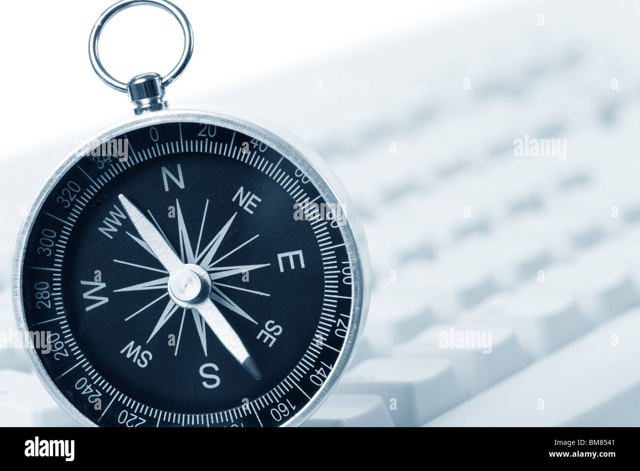 Computer Keyboard and Compass, internet concept - Stock Image