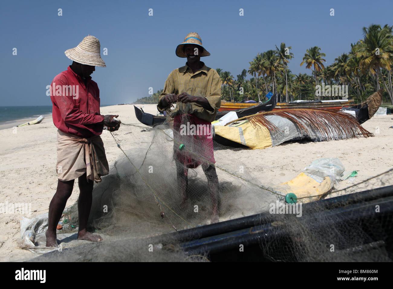 Fishermen working on Marari Beach or Secret Beach near the town of Alleppey in Kerala, India. Stock Photo