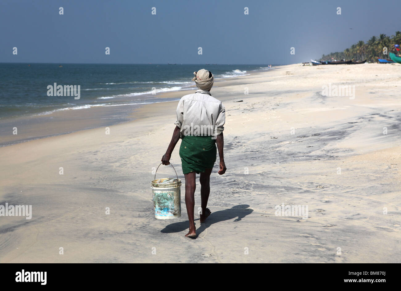 Fishermen working on Marari Beach or Secret Beach near the town of Alleppey in Kerala, India. Stock Photo