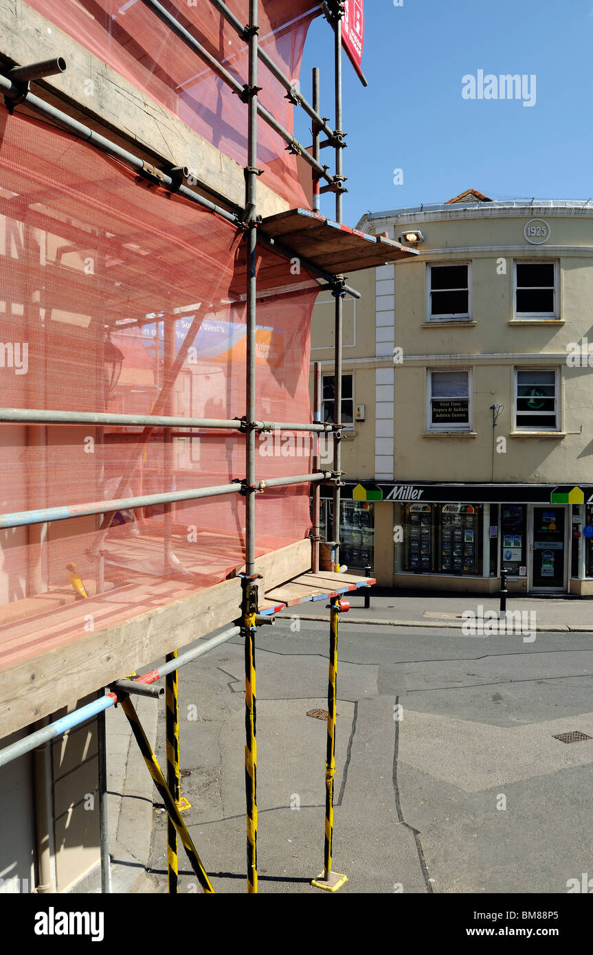 protective scaffold outside a building in the town centre of falmouth, cornwall, uk - Stock Image