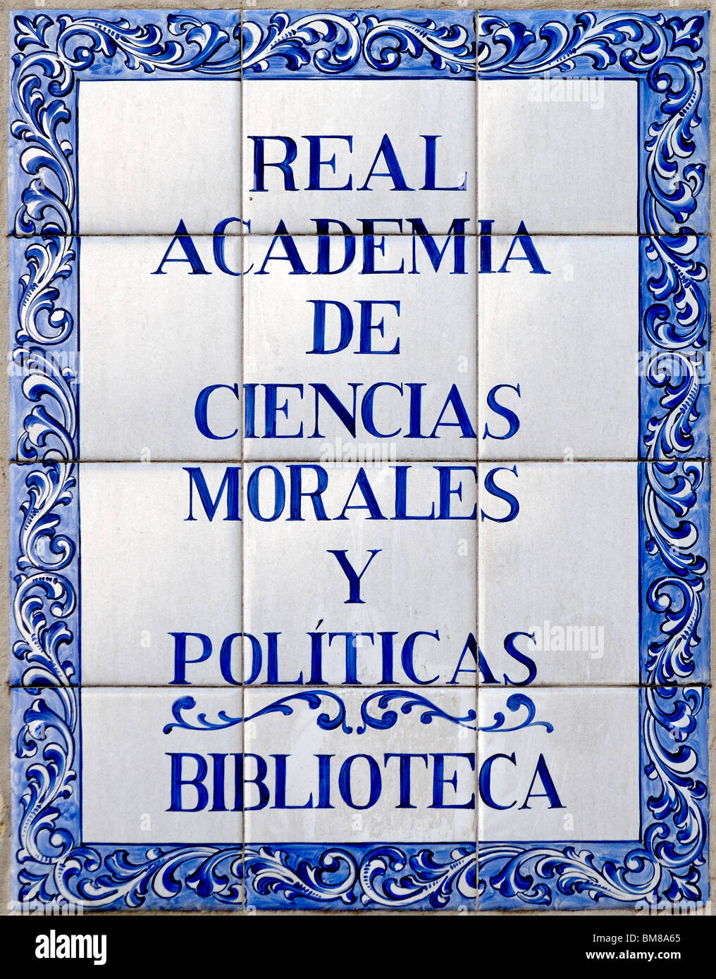 Madrid, Spain. Painted tiled sign of the Library of the Royal Academy of Moral and Political Sciences - Stock Image