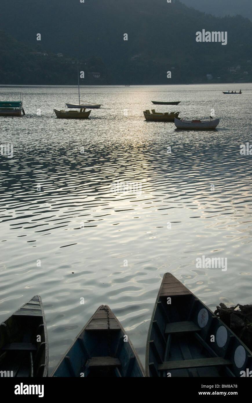Boats on lake, early evening, Phewa Tal lake, Pokhara, Nepal - Stock Image