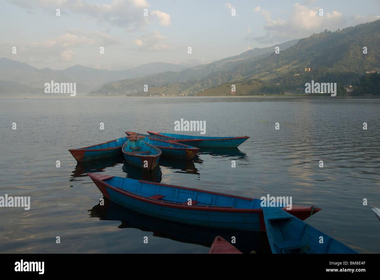Boats on lake, early morning, Phewa Tal lake, Pokhara, Nepal - Stock Image