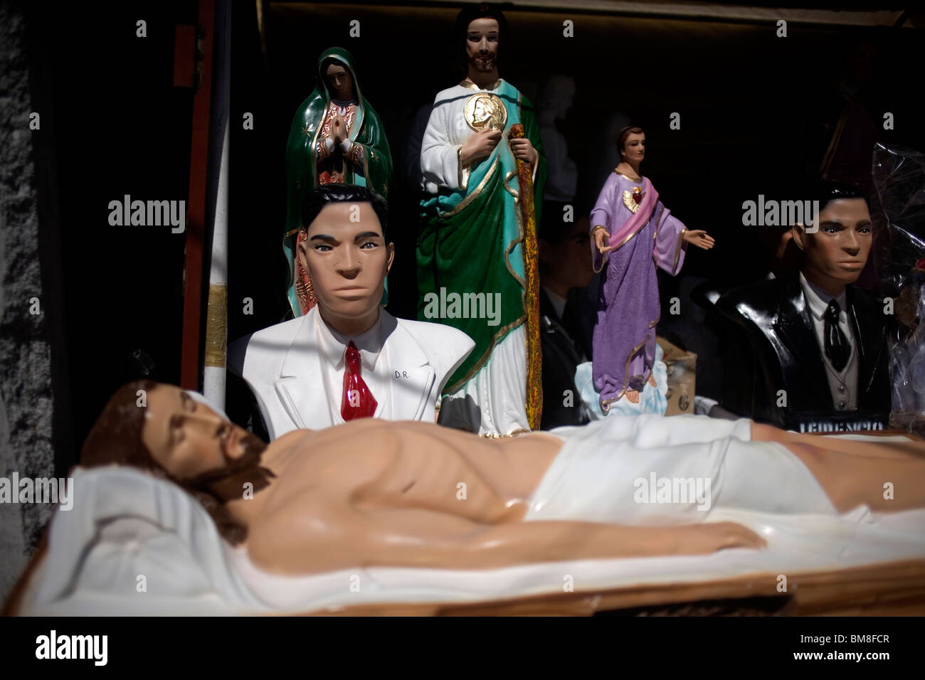 Catholic iconography and Nino Fidencio sculptures sit for sale in a shop during Nino Fidencio celebrations in Espinazo, - Stock Image