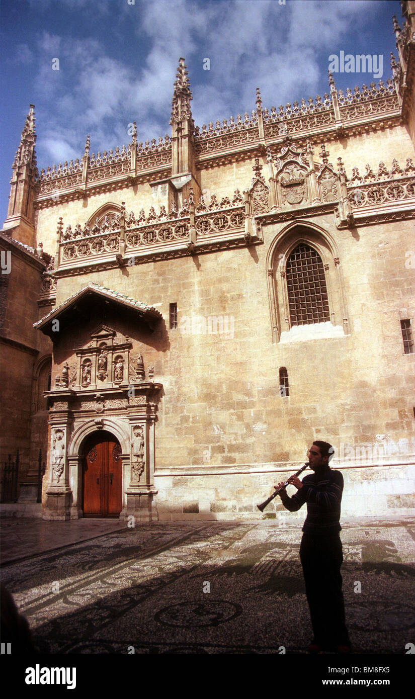 A musician plays the clarinet in front of the Cathedral in Granada, Andalucia, Spain, April 2005. Photo/Chico Sanchez Stock Photo