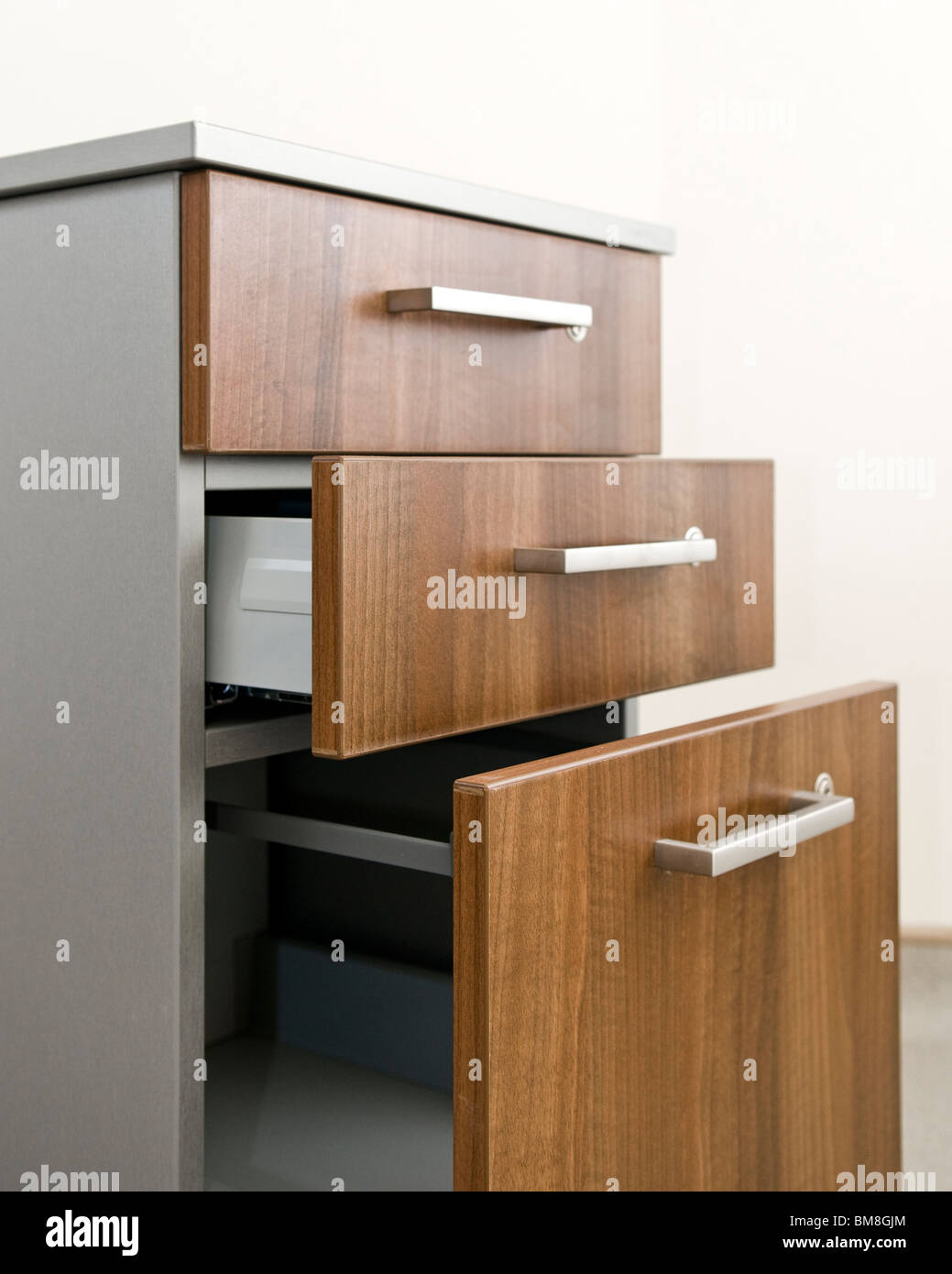 Drawer unit with opened drawers. - Stock Image