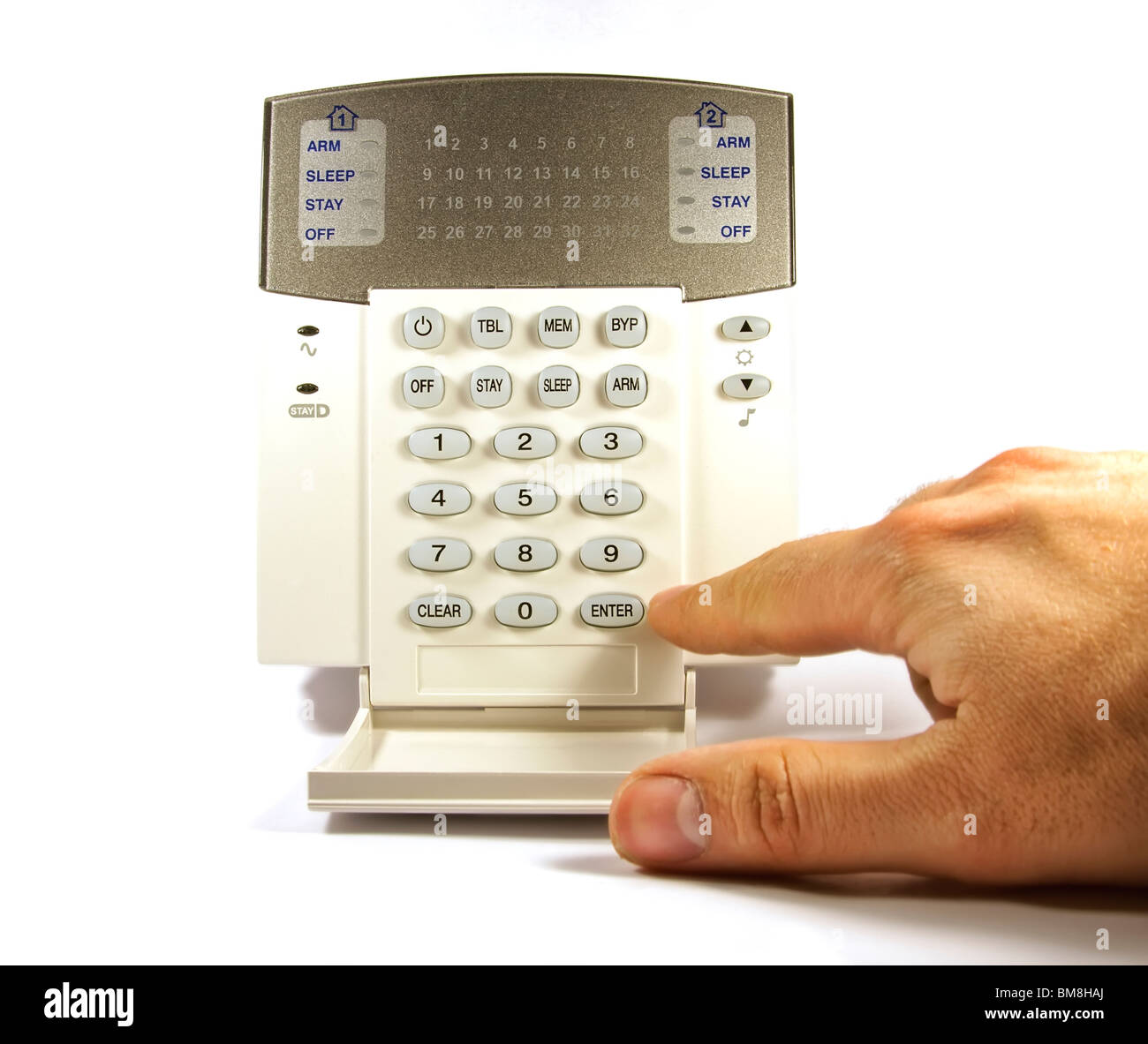 The hand enters a code on the security keyboard Stock Photo