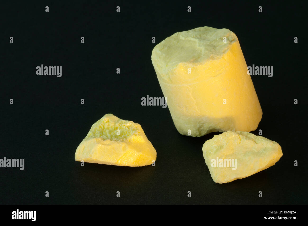 Sulfur, sulphur. Cast rods for industrial use. Studio picture. - Stock Image