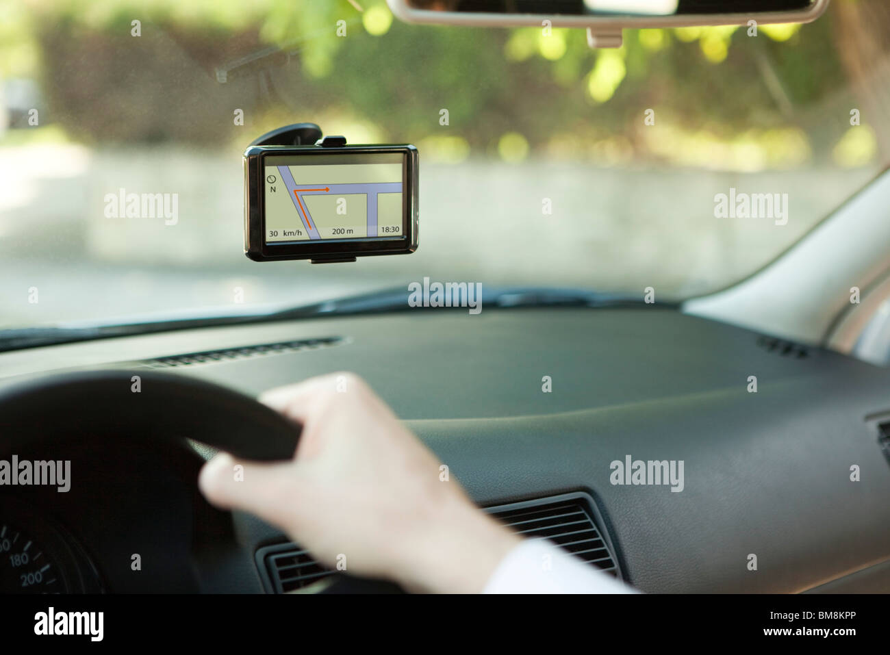Driver using GPS unit for navigation assistance - Stock Image