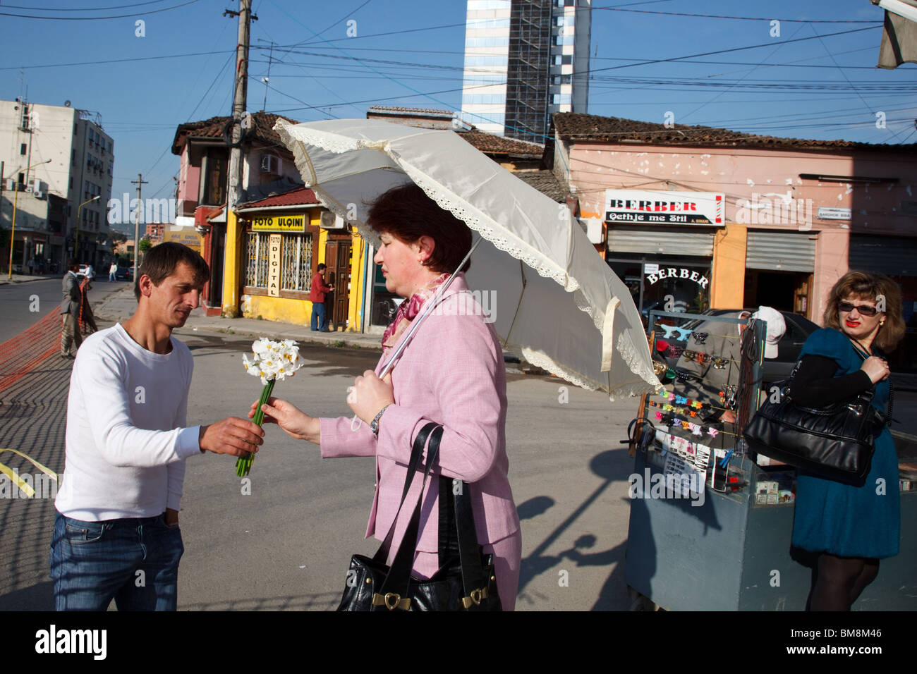 A woman buys flowers in Tirana, the capital of Albania. - Stock Image