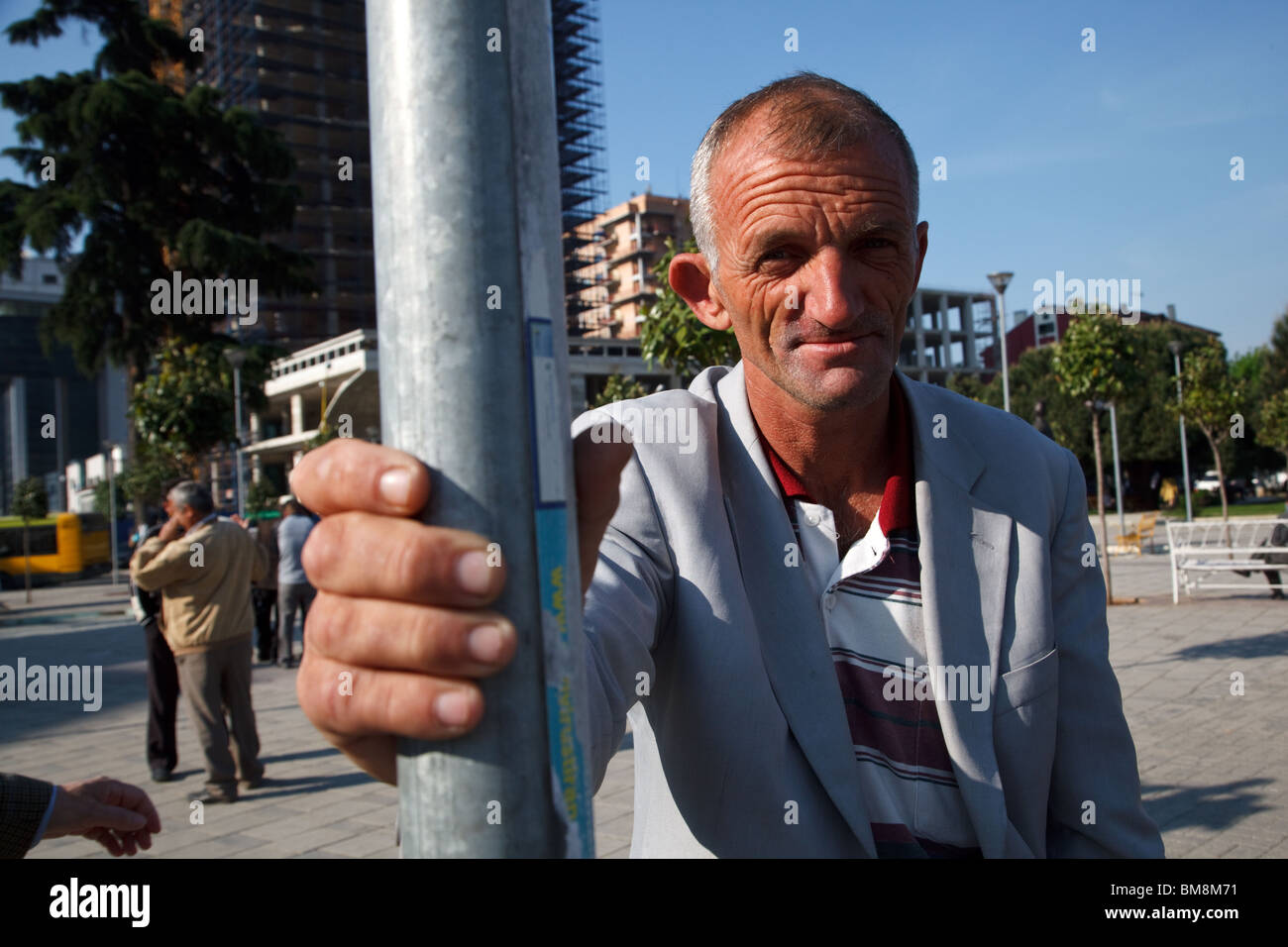 A day worker in Tirana, the capital of Albania. - Stock Image