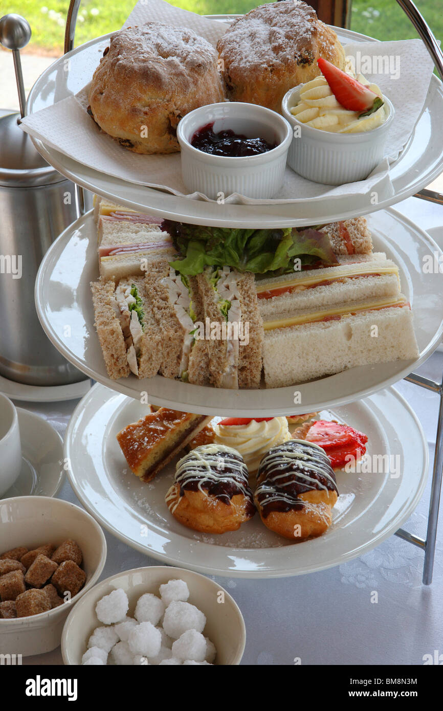 Afternoon tea with sandwiches, cream cakes and scones, Finger-cut Sandwiches,Tea for two - Stock Image