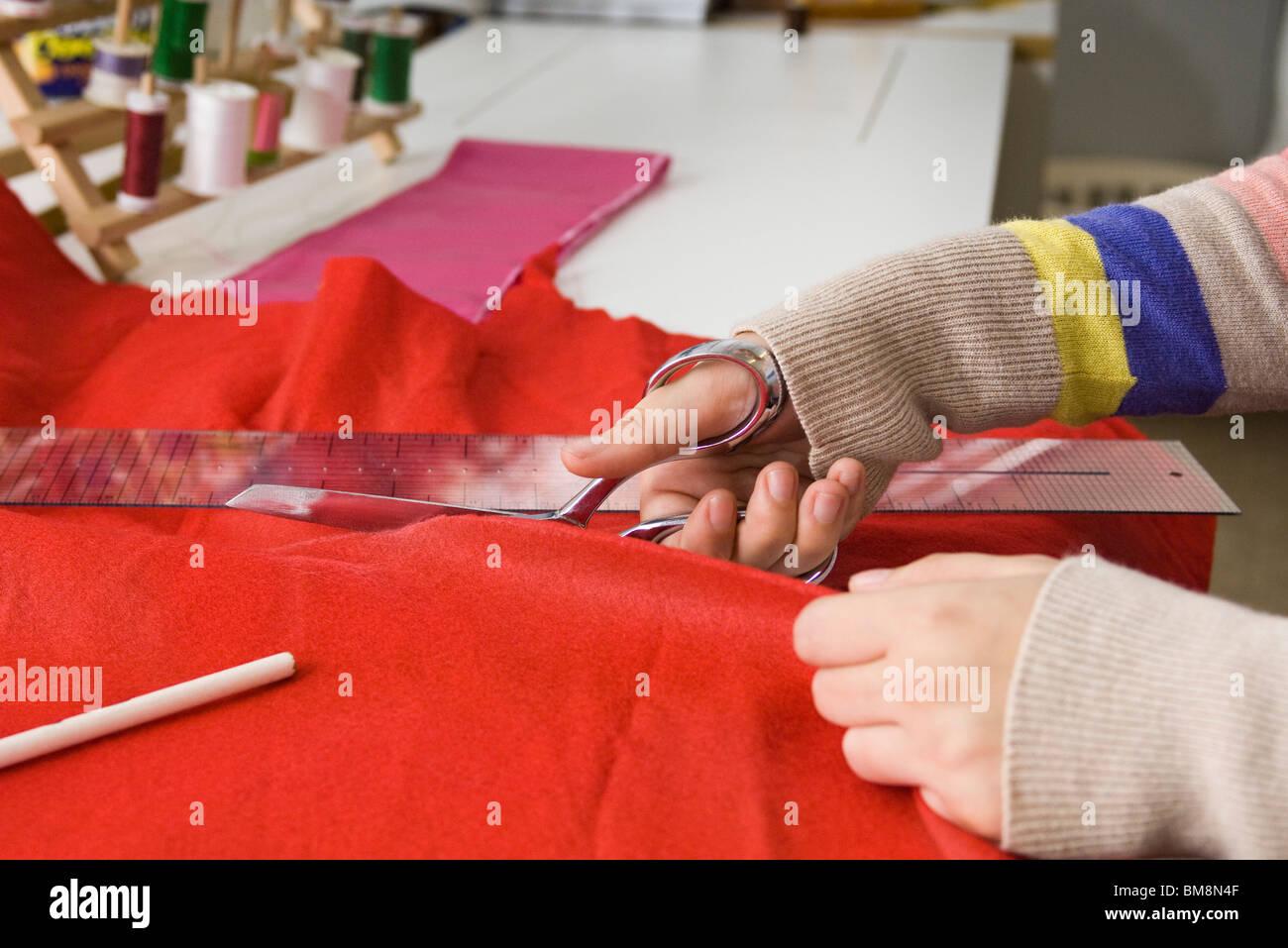 Cutting fabric - Stock Image