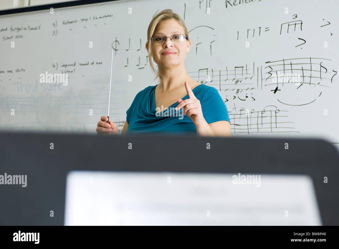 Music teacher conducting - Stock Image