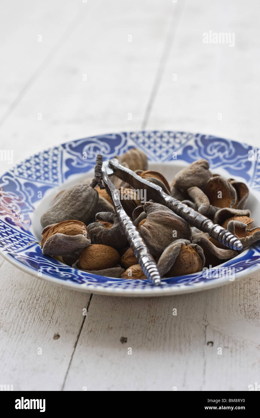 Almonds and nutcracker - Stock Image