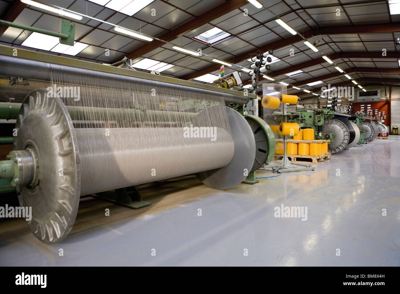 Fabric coating plant, weaving department, weaver's beam and loom Stock Photo