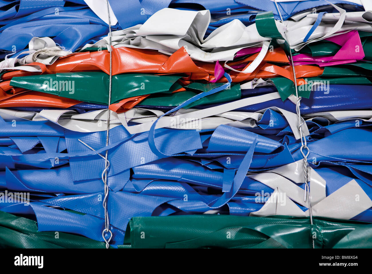 Bales of PVC sheeting to be recycled - Stock Image
