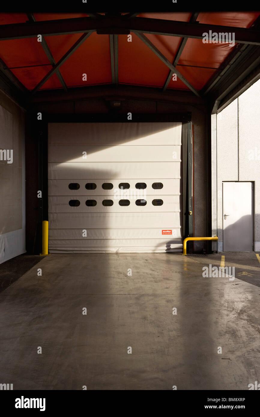 Roll-up door of warehouse - Stock Image