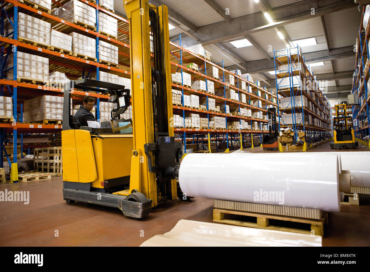 Warehouse stocked with coated fabic products - Stock Image