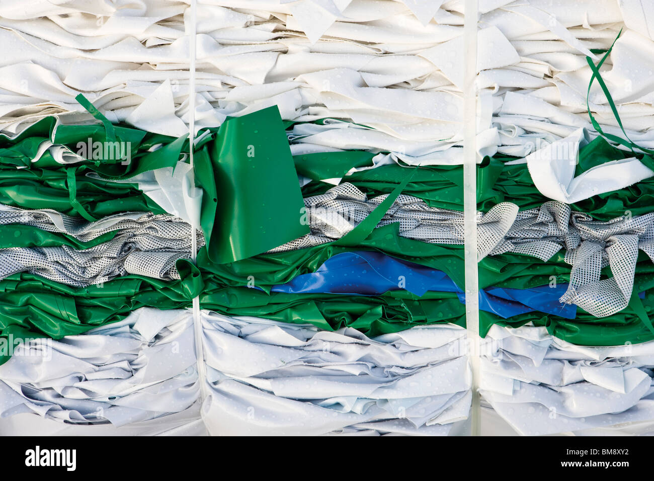 Storage of bales of PVC sheeting for recycling - Stock Image