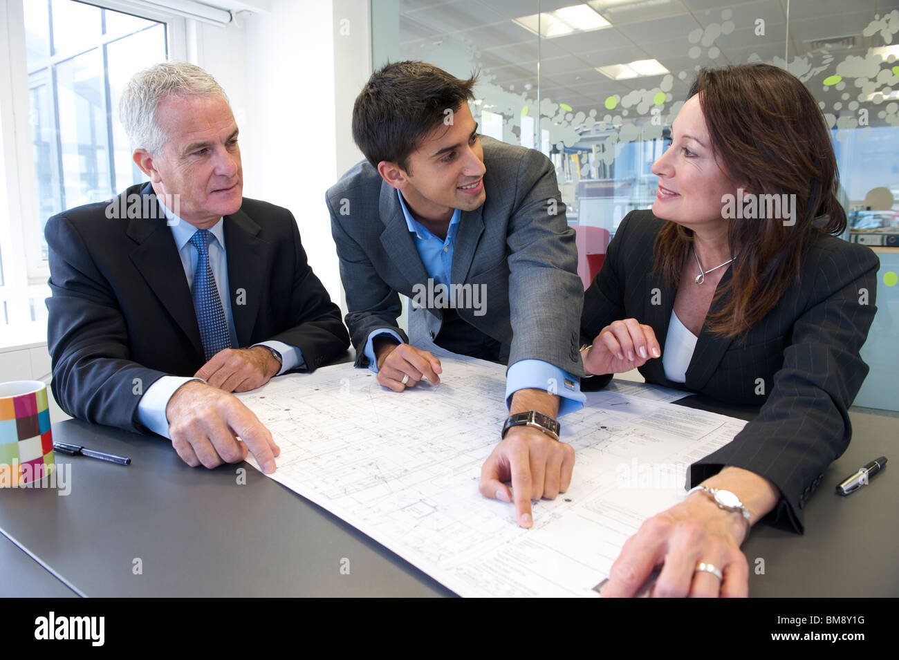 Business meeting with plans - Stock Image