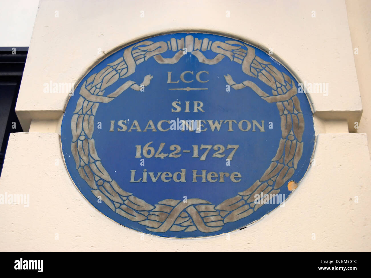 london county council blue plaque marking a home of sir isaac newton, in jermyn street, london, england - Stock Image